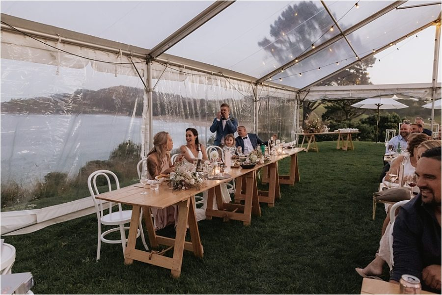 Groom gets emotional during speeches at Orua beach house reception in marquee
