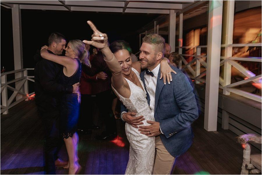 Bride and groom on the dance floor at Orua Beach house