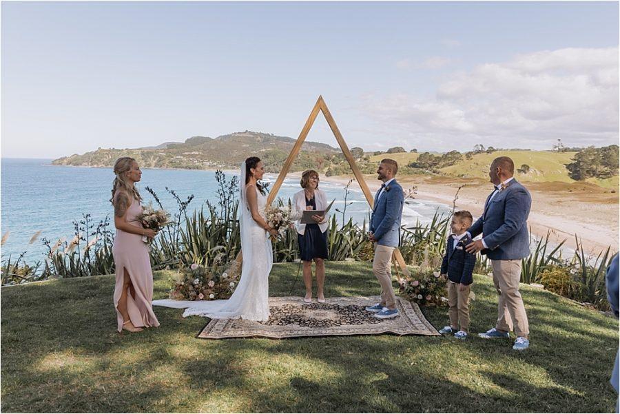 Wedding ceremony on cliff face at Orua beach house