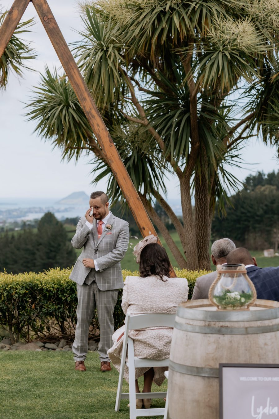 Emotional crying groom on seeing his bride