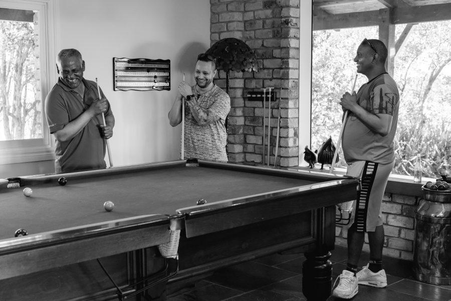 Groomsmen playing pool