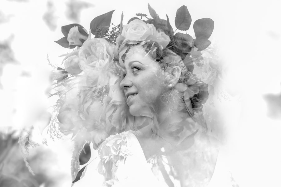 Double exposure of bride and her bouquet
