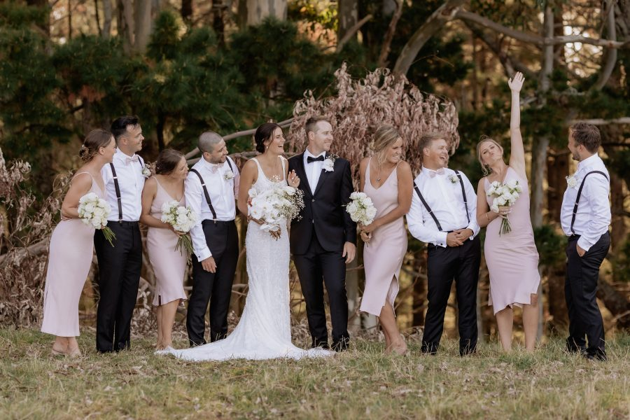 Pink bridal party in the country having fun