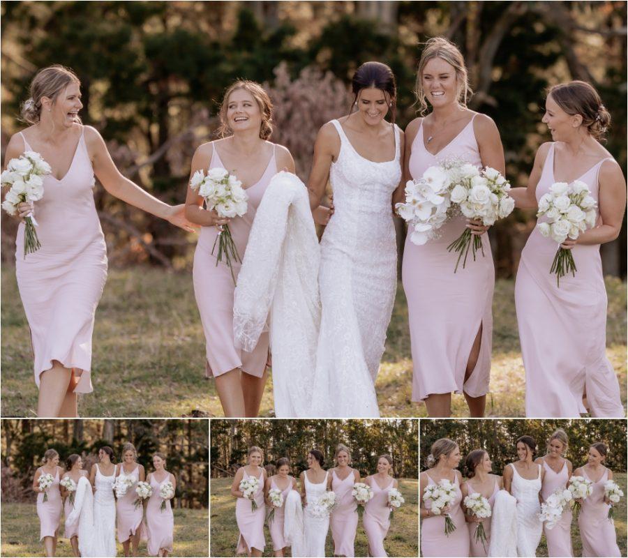 Bride and pink bridesmaids dresses walking happy