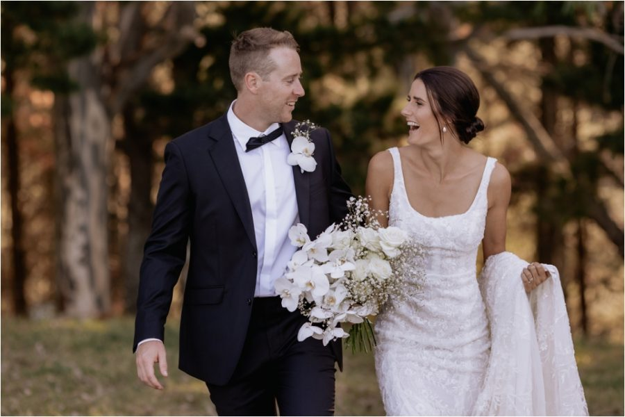 Candid natural moments between bride and groom