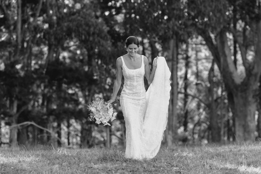 Bride lace dress walking in field