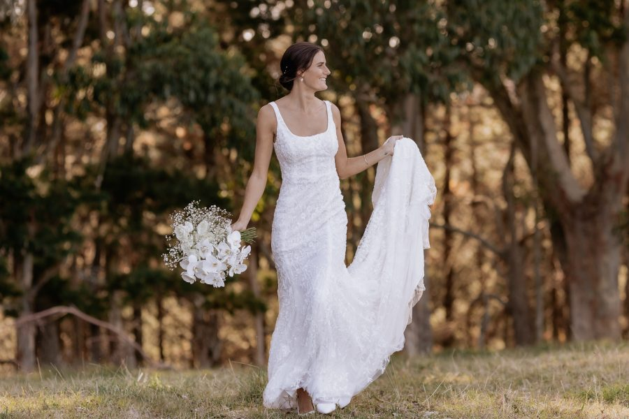 Bride in white lace dress looking away