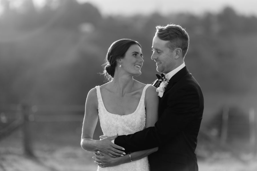Black and white couple looking at eachother