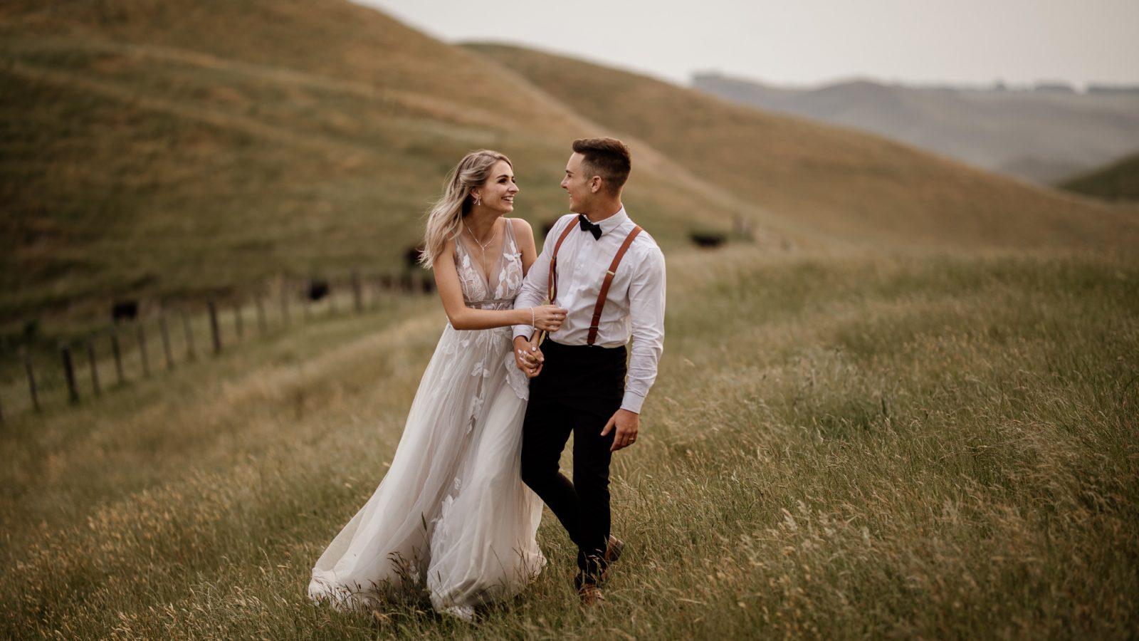 Waiterenui Wedding Venue Hawkes Bay hills couple walking laughing