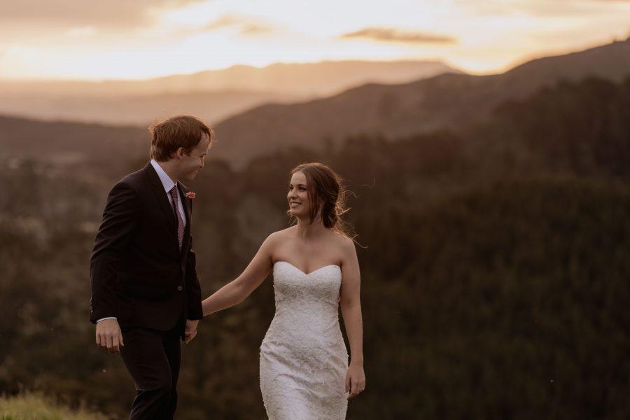 Walking in golden hour on their wedding day