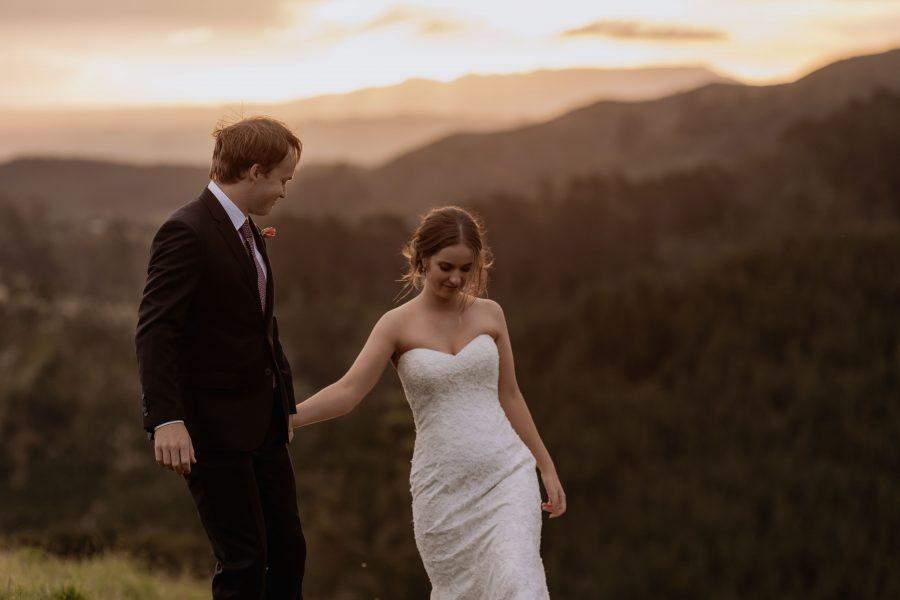natural unposed walking bridal couple at sunset