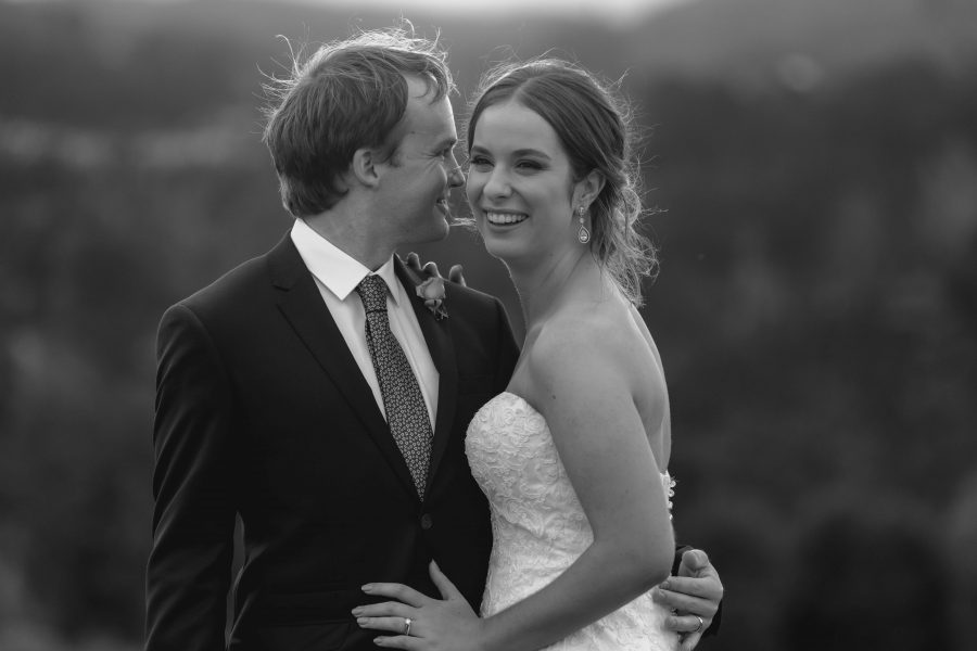 Happy candid moment of NZ Bride and Groom