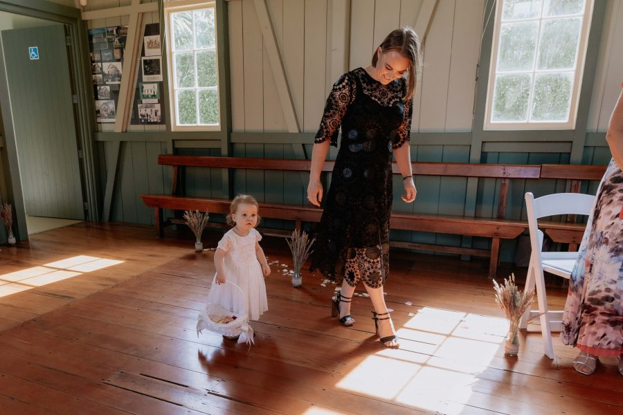 Flower girl with bridesmaid in black dress