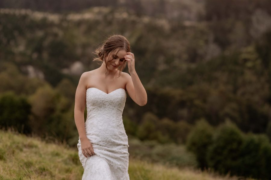bridal portrait moves hair off face