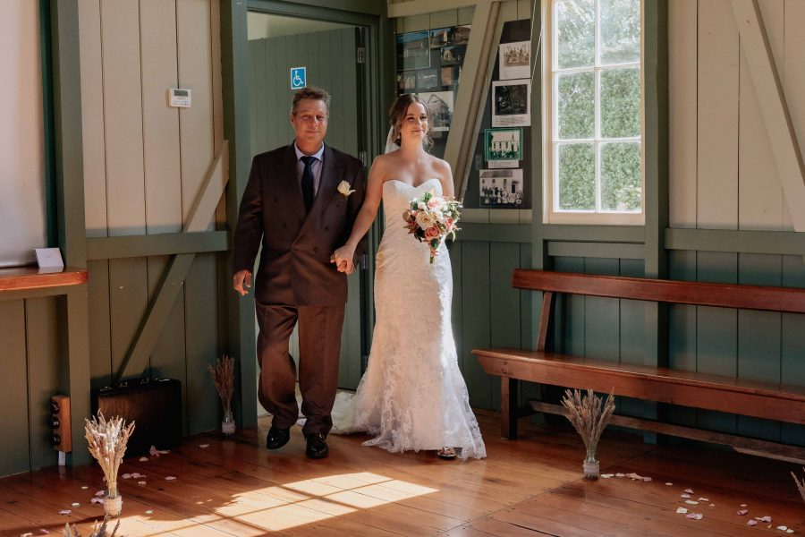 Father of the bride and daughter walking down the aisle at number 2 road country hall
