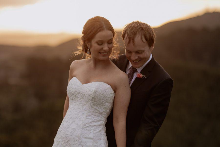 wedding couple giggling togetehr