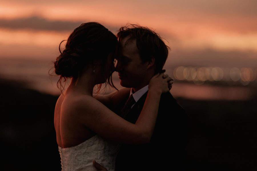 Late golden light of bride and groom embracing