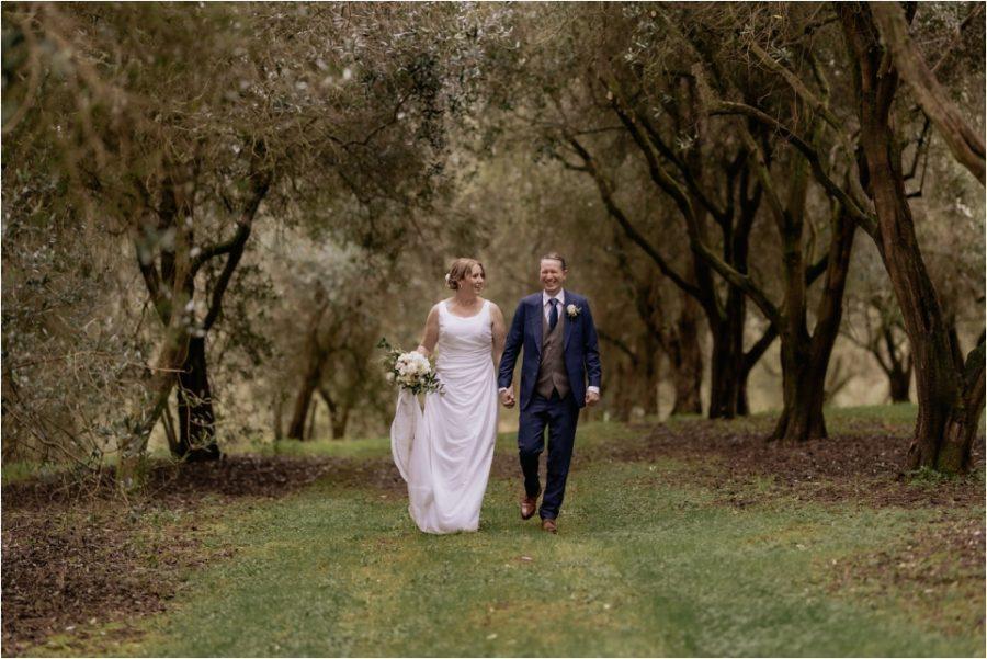 Bride and bride walking at Bracu