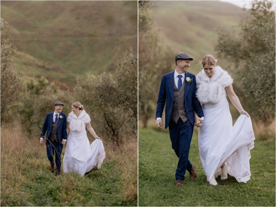 top of hill bride and groom walking in olive groves