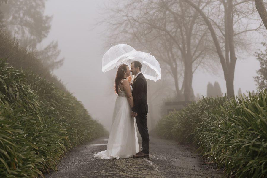 Wedding photos in the rain with lit umbrellas