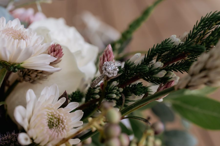 engagement ring in flowers bouquet