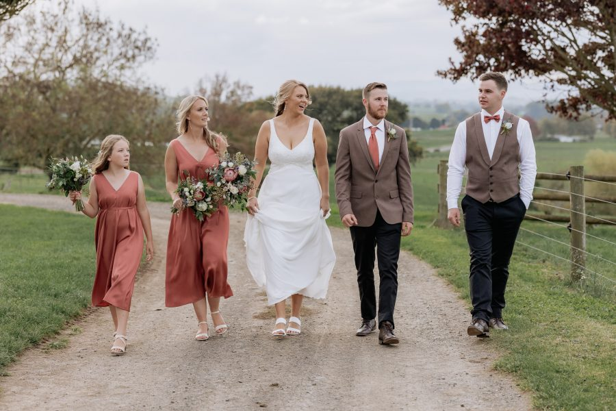 smoky browns country wedding party walking