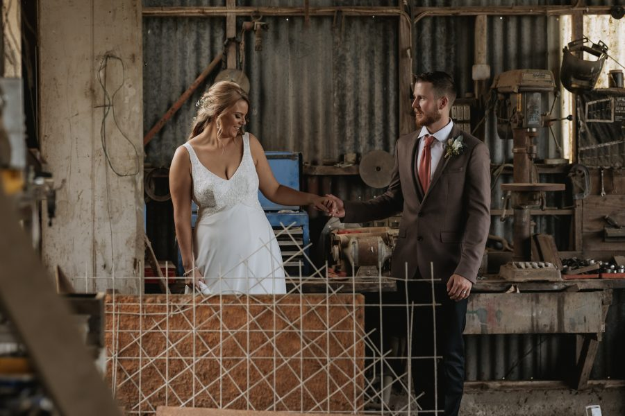 canidid moments with bride and groom in country shed