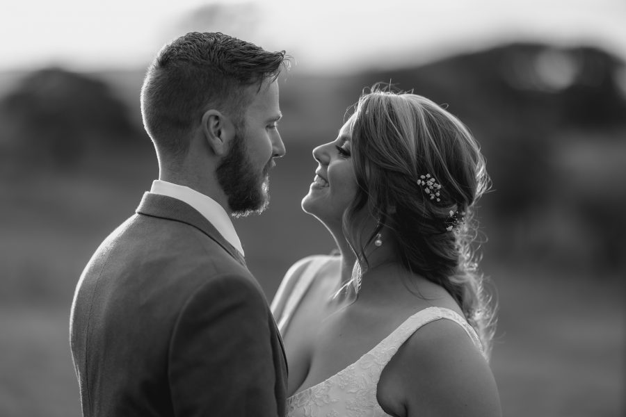 intimate moments with bride looking at her husband