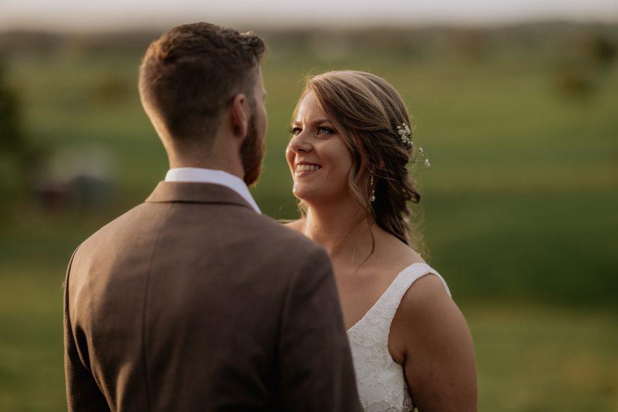 natural romantic happy bride looking at groom