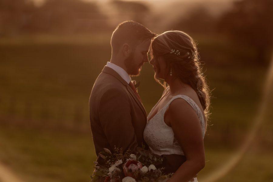 golden hour photos of farm wedding bridal couple