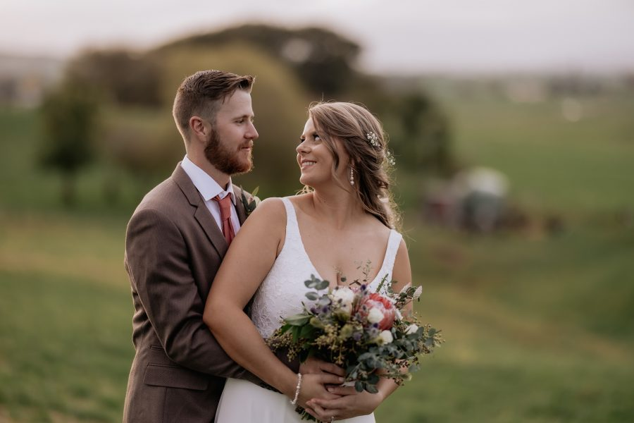 bride turning to look at groom countryside rustic wedding