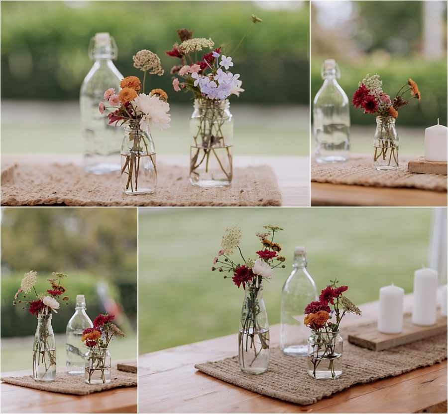 table settings country vases with flowers on hessian runners