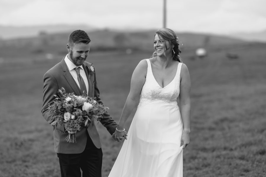 laughing happy natural photo of bride and groom