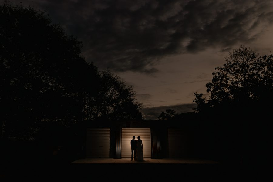 wedding photos in the evening with farm shed door lit up