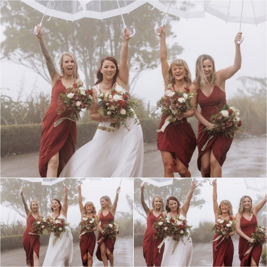 Fun bridemaids laughing in the rain