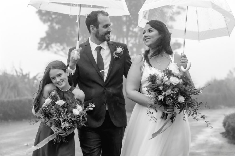 Walking with flower girl in the rain