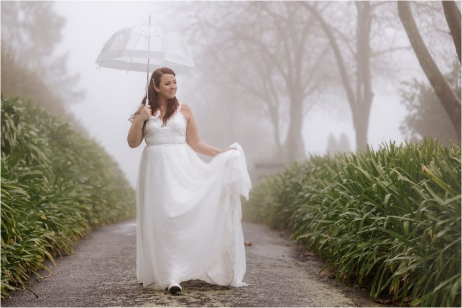 Bride walking in the rain in the clouds