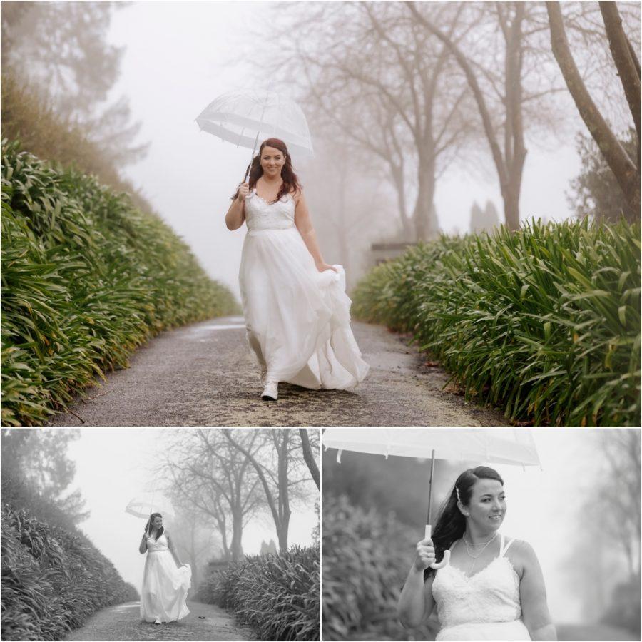Rainy day wedding photos with bride holding umbrella on drive