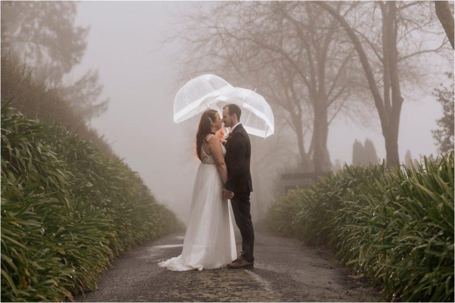 Wedding photos with lit umbrellas on wet rainy day