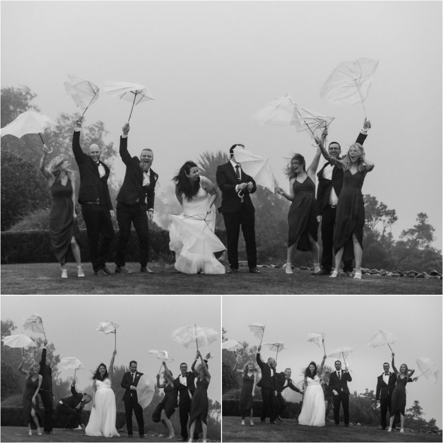 wedding party umbrellas blown inside out party laughing having fun